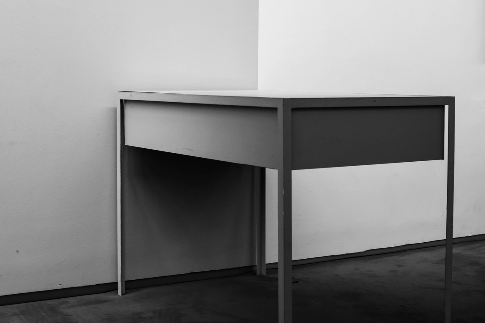 Minimalist table against a blank white wall